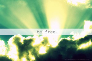 the words Be free over a cloud covering the sun