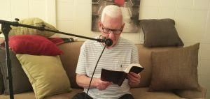 Steve Sumrall reading from the bible into a microphone