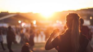 Image of people and a sunset in the background
